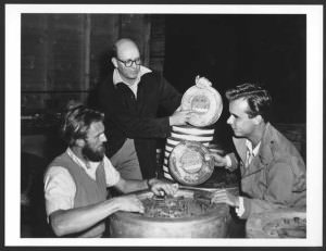 Two crew members with 20th Century Fox insulated film cans containing the feature film Kangaroo (1952)_423807