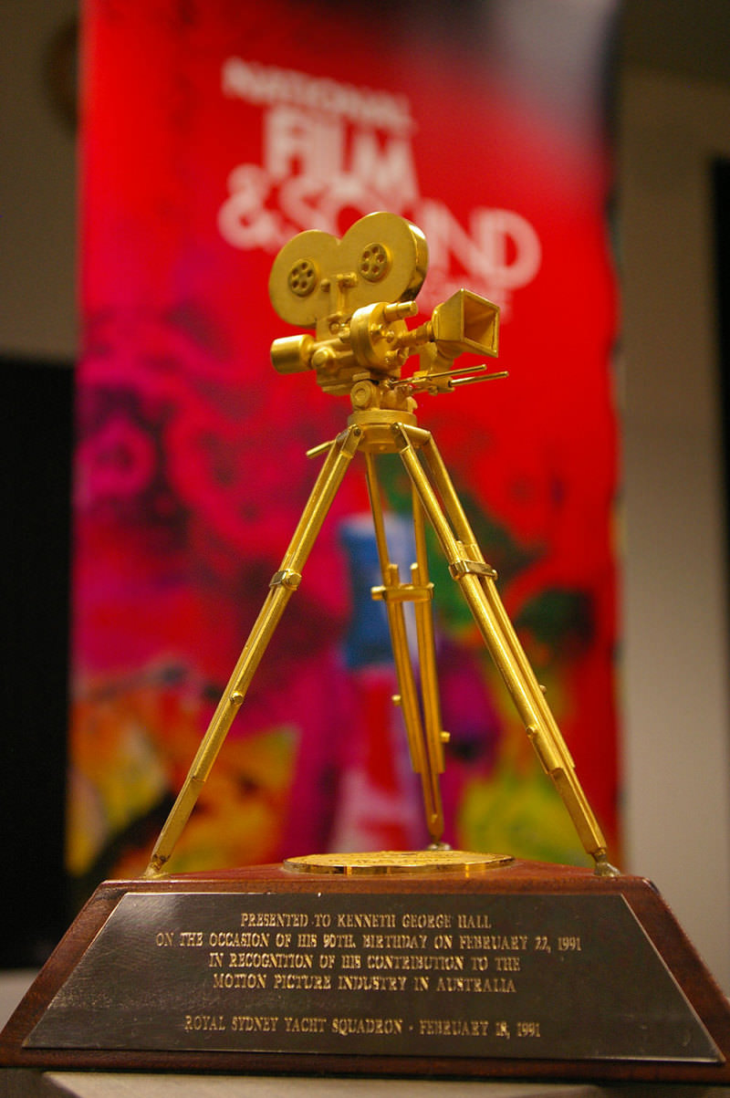 The Ken G Hall Film Preservation Award, a gold tripod camera on a wooden base